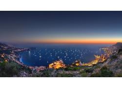 夜景晚霞臨海城市攝影圖片