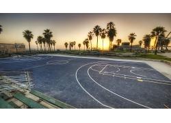晚霞海灘海邊海濱城市籃球場椰樹天空風景景觀照片