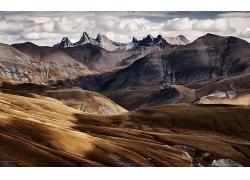 草地秋季枯草地大山岩石天空风景风光景观照片