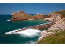 海边沙雕沙滩高山荒废草地景观风景高清图片