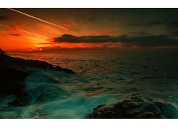晚霞紅色天空大海沙灘海上海浪浪花景觀風景高清圖片