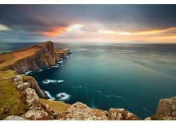 海边大海海边石头天空晚霞景观风景高清图片