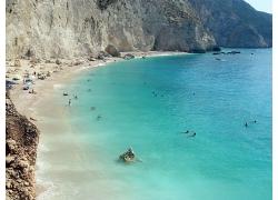 希腊爱情海蓝色海水沙滩海边高山景观风景高清图片