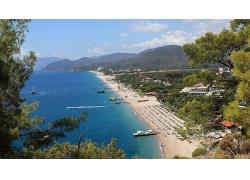 美丽蔚蓝海水大海海边海滩沙滩海边城市景观美景高清图片