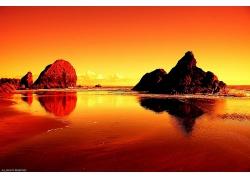 美丽晚霞余晖红色海滩海岸日落景观美景高清图片
