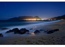 美丽晚上夜晚海滩海岸日灯火景观美景高清图片