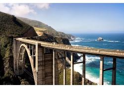 风和日丽大海高山大桥景观海边美景高清图片